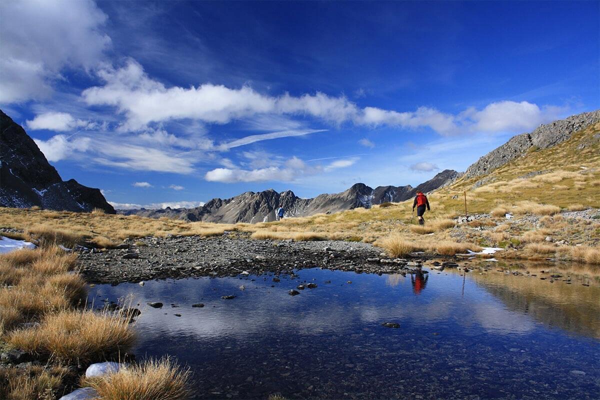 hiking lake blue sky
